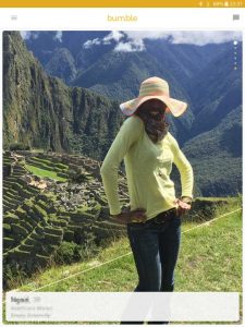 Example of a Bumble profile picture: black girl posing at Machu Picchu