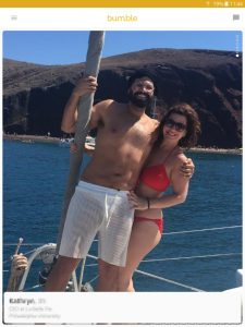 Example of a Bumble profile picture: couple on a boat