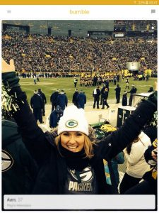 Example of a Bumble profile picture: female Green Bay Packers fan at stadium