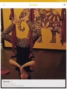 Example of a Bumble profile picture: woman doing aerial yoga