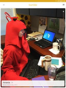 Example of a Bumble profile picture: woman in a lobster Halloween outfit