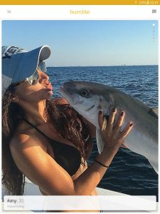 Example of a Bumble profile picture: girl kissing a caught fish