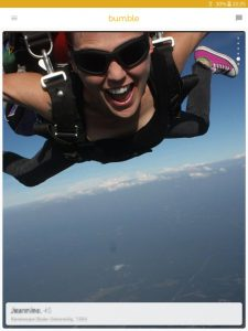 Example of a Bumble profile picture: girl sky diving