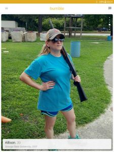 Example of a Bumble profile picture: girl with a shotgun