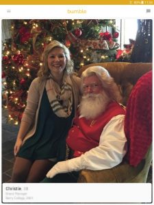 Example of a Bumble profile picture: woman sitting on Santa Claus' lap