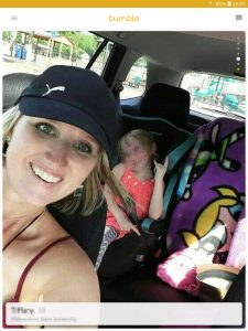Example of a Bumble profile picture: mother with her child in car