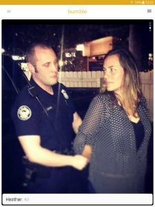 Example of a Bumble profile picture: woman getting arrested