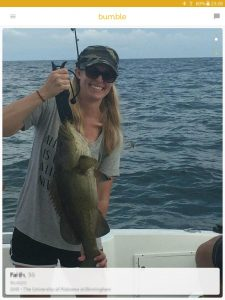 Example of a Bumble profile picture: woman showing her catch