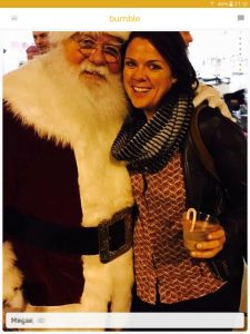Example of a Bumble profile picture: woman hugging Santa Claus