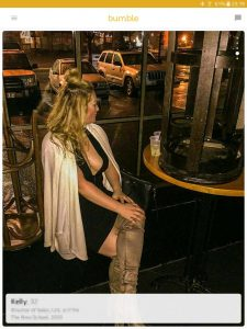 Example of a Bumble profile picture: woman waiting at a bar