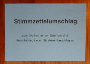 German Bundestag election absentee ballot: blue mail-in envelope