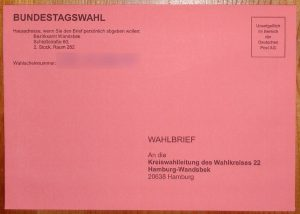 German Bundestag election absentee ballot: pink mail-in envelope