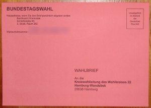 German Bundestag election absentee ballot: pink mail-in envelope